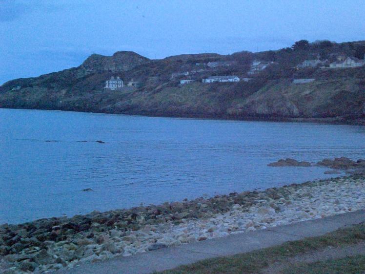 The Irish coast just after sun set. DUBLIN.