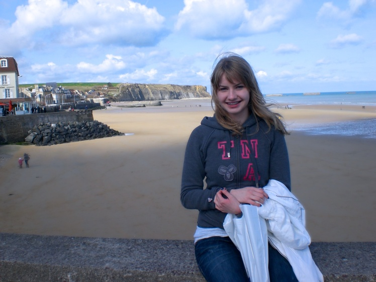 Sitting on part of demolished bunker on the D-Day beaches. NORMANDY.